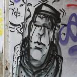 Graffiti bildlich: Mann mit Hut